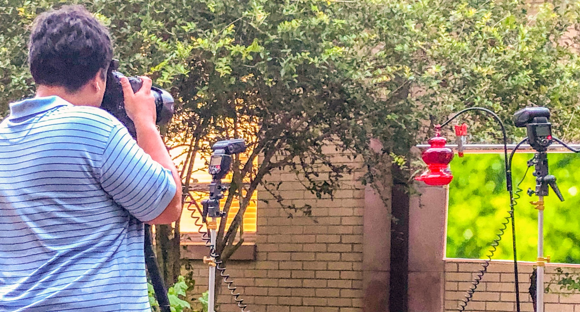 Alex Meza photographing hummingbirds in Wildlife Photography class