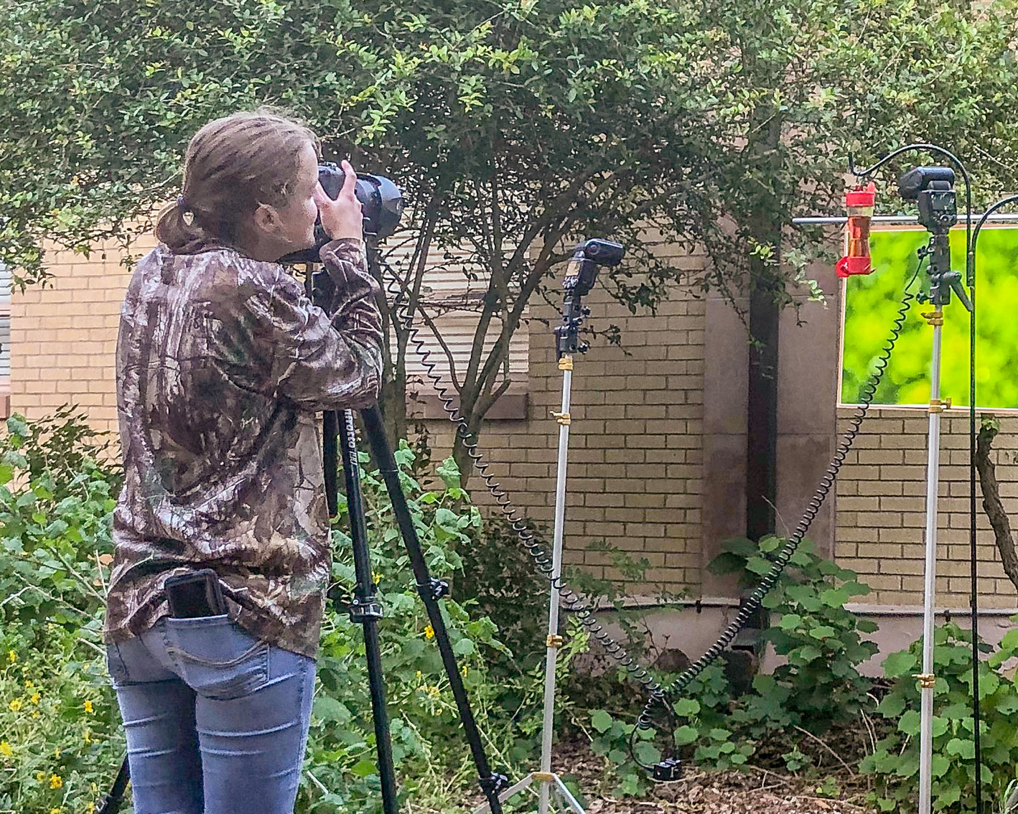 Kelly Wood photographing hummingbirds in Wildlife Photography class